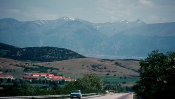 valley of roses, mountain view and a road