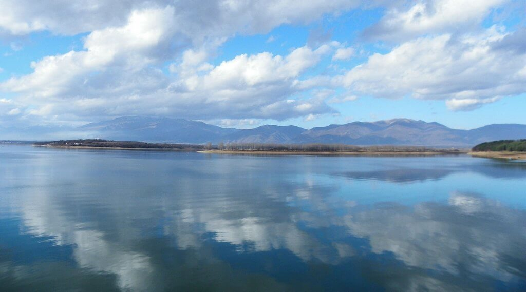 Sky perfectly reflected in the water at the Koprinka dam in Kazanlak.