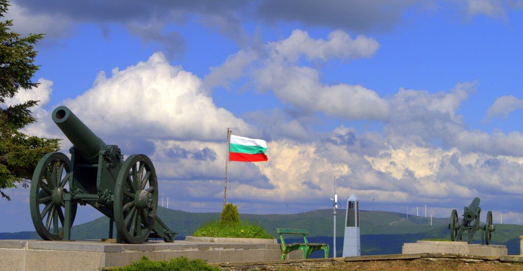 The bulgarian flag and a cannon, view towards northern Bulgaria