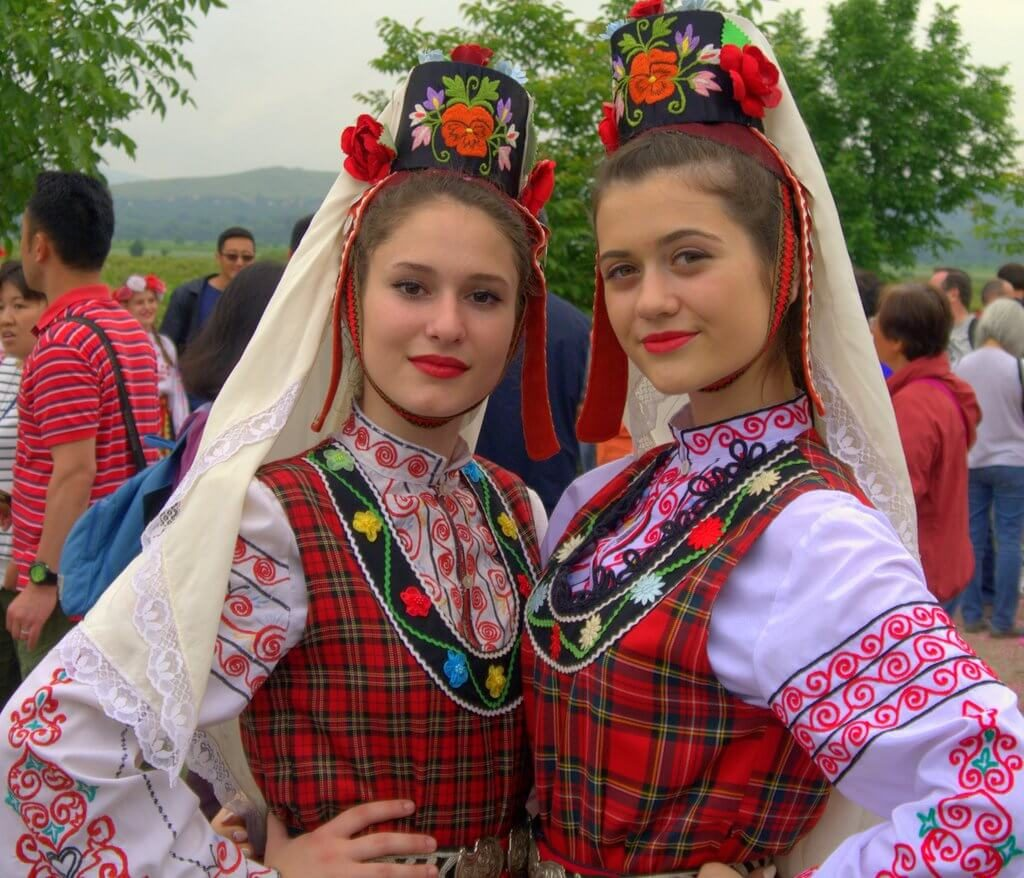 Rose Festival Kazanlak: Girls with Traditional Bulgarian Folklore clothing during the rose-picking ritual near Kazanlak, Bulgaria