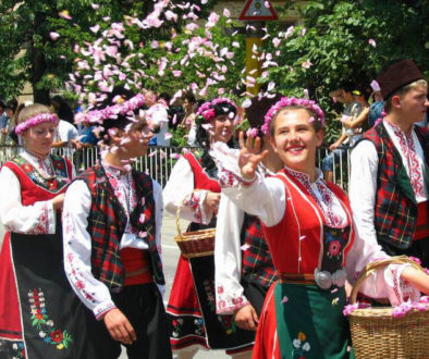 Rose pickers throwing rose petals during the Rose Festival Parade in Kazanlak, Bulgaria